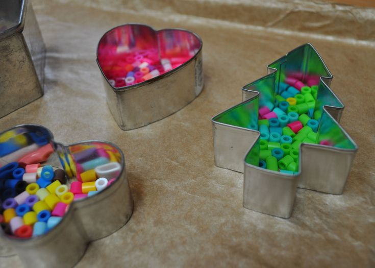 Love this idea - melty beads in a cookie cutter. I bet this would be cool to melt broken crayon pieces into shapes!