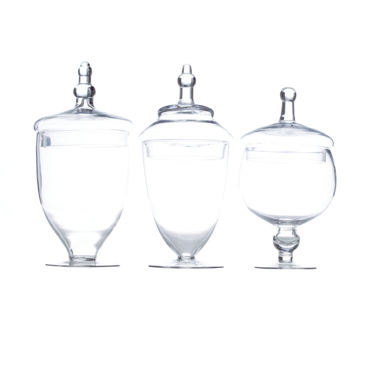 "Glass Apothecary Jars (Set of 3) $39.98 Koyal Wholesale  Dimensions (including the lid):  Large 14"" tall with 6"" opening diameter Medium 13.75"" tall with 5.6"" opening diameter Small 12"" tall with 5.3"" opening diameter"