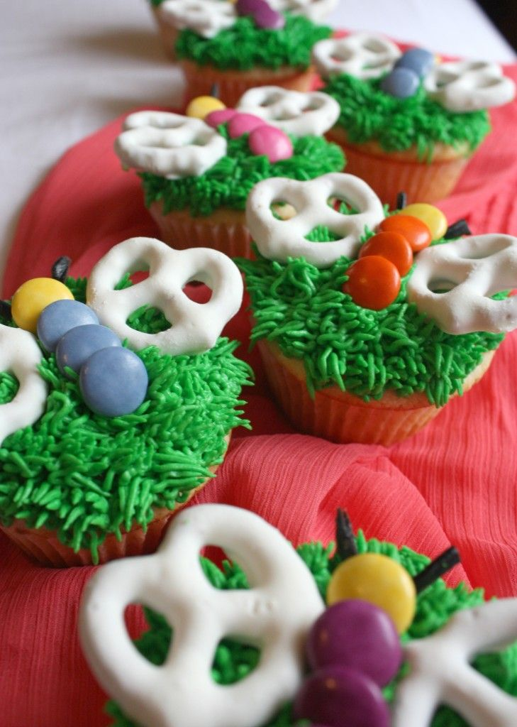 butterfly cupcakes with smarties, white chocolate covered pretzels and black licorice