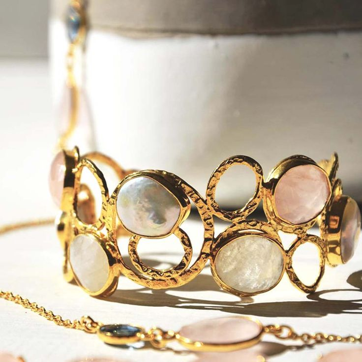 Cuff and Stone sterling silver and gold cuff with pearl, rainbow moonstone and rose quartz gemstones.