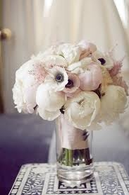 Light pink and white. Peonies and anemone. Beautiful. With little burgundy accessories. Pictures and my locket.