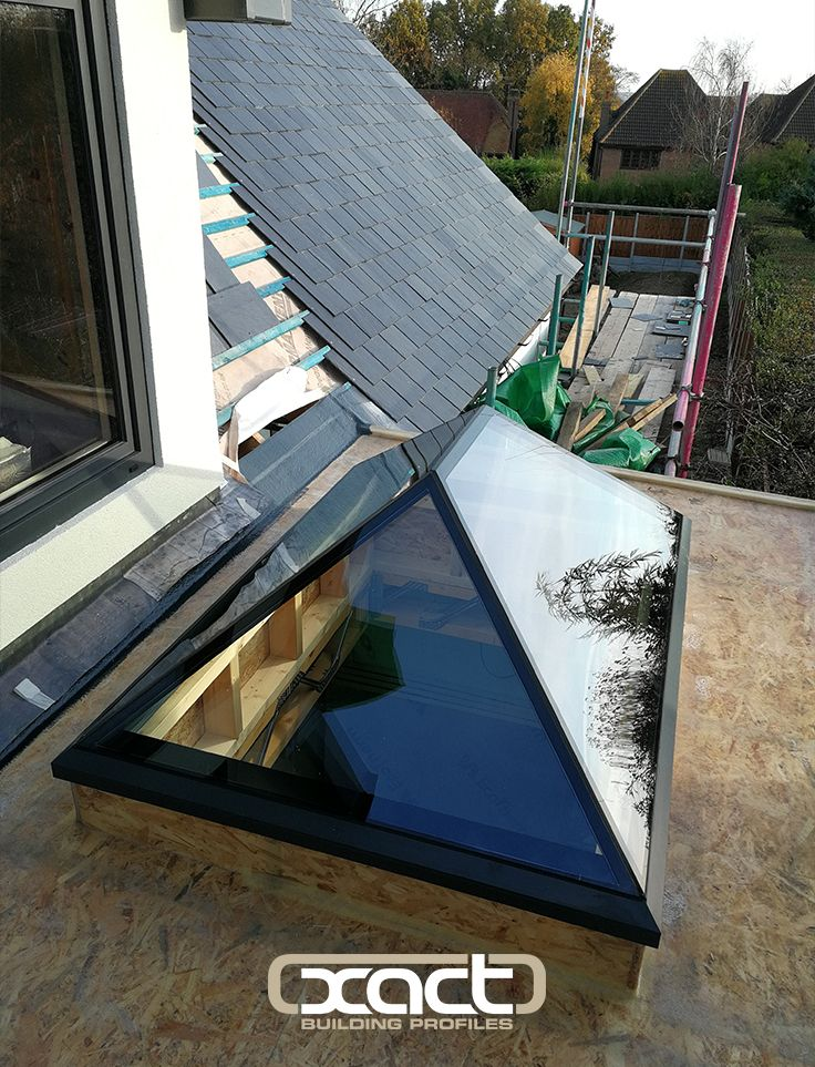 XACT Pure Glass Roof Lantern installed in Highams Close, Essex. The XACT Pure Glass Roof Lantern is a unique design frameless glass roof lantern. The glass roof lantern's clean, minimalist design makes it a fantastic choice for both modern and traditionally styled properties. #rooflight #rooflantern #skylight #roofglass #frameless #extensionideas