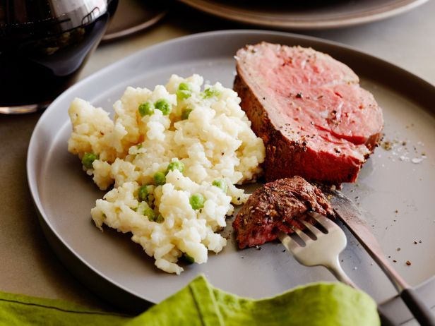 """Filet of Beef : Four ingredients and five minutes of prep work are all that's needed to pull off Ina's elegant Filet of Beef. Round out the meal by serving the meat with her Easy Parmesan """"Risotto."""""""