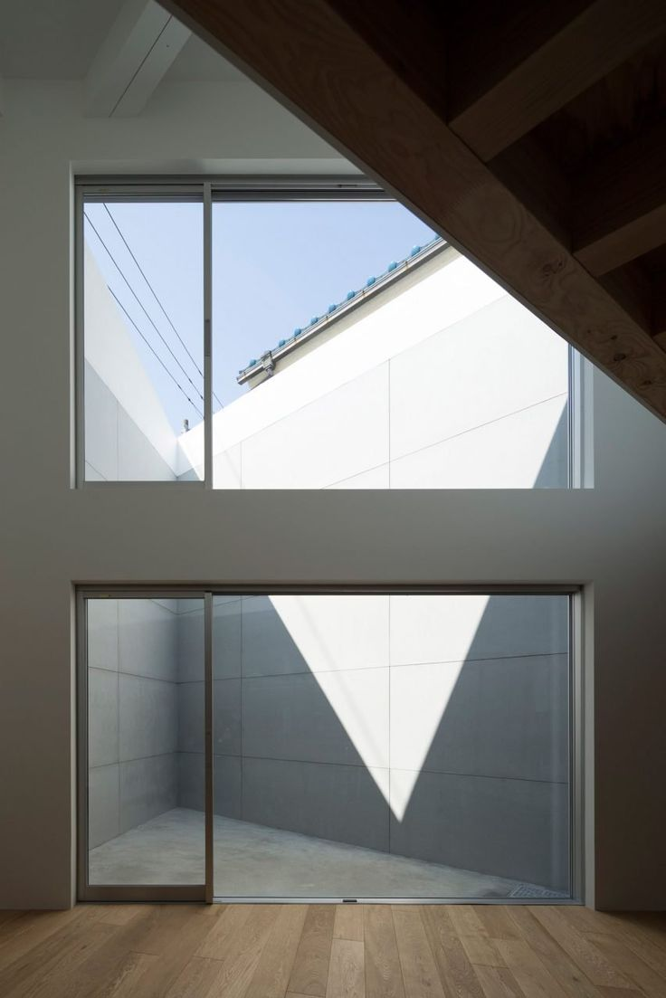 """Japanese architecture studio Chop + Archi has used a trio of courtyards to make the most of the sharp """"dead space"""" corners of this house, located on an almost triangular plot in Tokyo."""