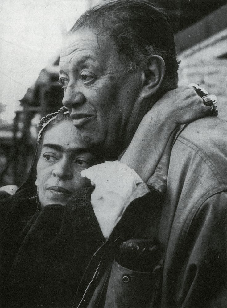Frida Kahlo and Diego Rivera her arm around his neck, last picture of them together before her death 1954