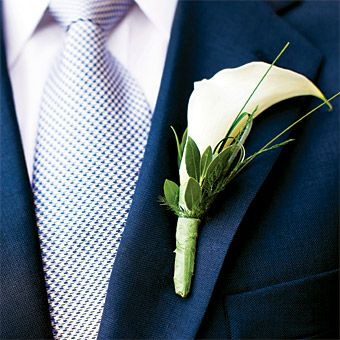 Brides.com: Lauran and Nicholas in Naples, FL. Nicholas sported a navy-blue suit by Bachrach and a calla lily boutonniere.