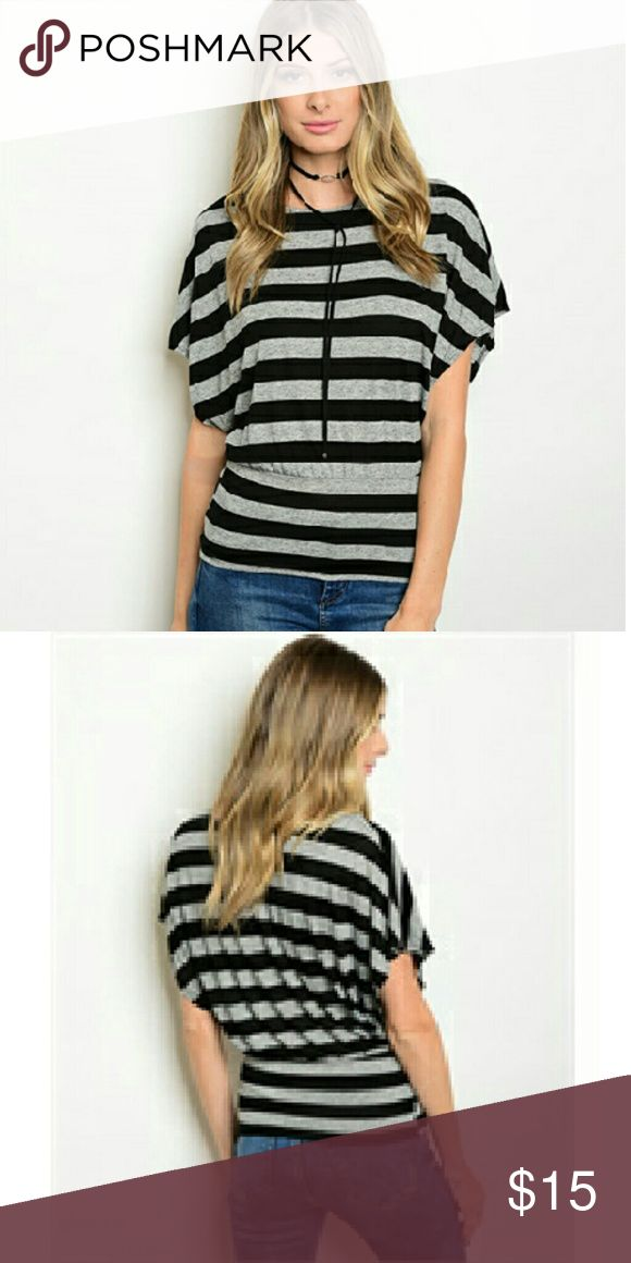 "Black / Gray Top This cute and trendy knit striped top features a banded hem and batwing sleeves. The fabric is 85% polyester/15% spandex. I have them in sizes s,m,l. The measurements are 25"" long x 15"" bust x 12"" w on a small. They are from a smoke free/ pet free home. Tops Blouses"