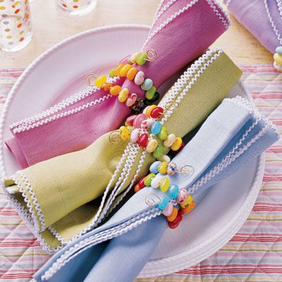 DIY Jelly Belly napkin rings ~ Thread small, brightly colored jelly beans on 22-gauge tin wire, long enough to wrap around a rolled napkin twice. Curl ends into swirls to keep candy in place.