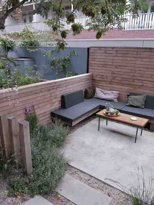 .Like the idea of a suspended bench - maybe use fore legs and pallets? In summer cushions in winter bare with a couple of boxwood plants...