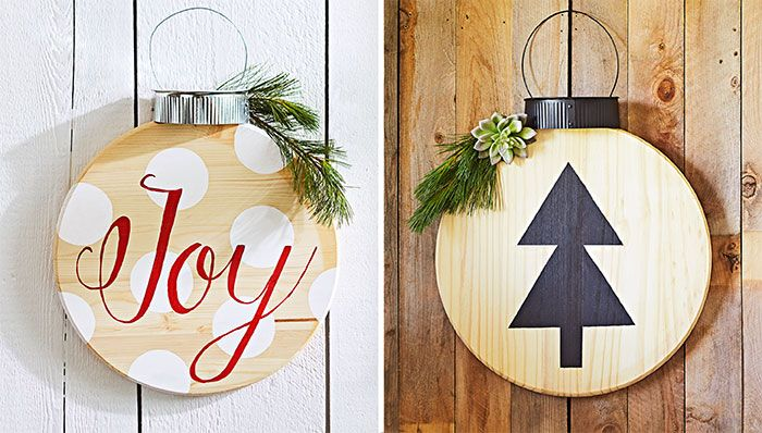 Christmas ornament-shaped wall decorations made from round pine panels.