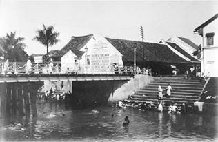 The bridge over Ciliwung river seen from across Gedung Kesenian Jakarta. At that time people were washing there.