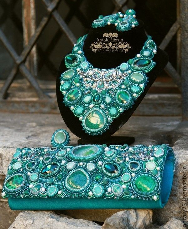 Women accessories set in blue and mint colors. Bag, necklace, earrings. High fashion.