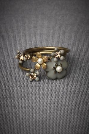 The smoky grey and topaz palette by Eric et Lydie's adjustable or namentation stacking rings.
