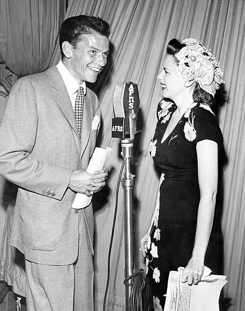 Frank Sinatra & Judy Garland perform on an armed forces radio program.