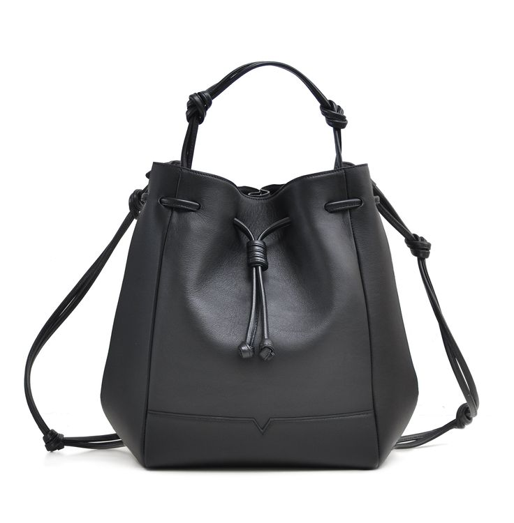 The Bucket Backpack in Black from von Holzhausen featuring natural grained soft Italian leather with painted edges.  Wear it as a backpack, shoulder bag, or handheld style.