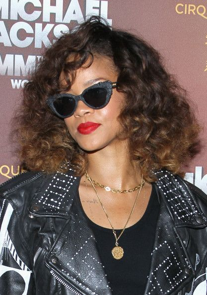 Rihanna Red Lipstick - Rihanna wore a rich ruby red lipstick when she attended the opening of Cirque du Soleil's 'Michael Jackson The Immortal World Tour.'