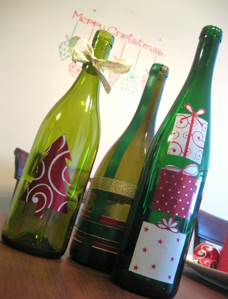 Make Christmas decorations with old bottles, gift wrap and Mod Podge.