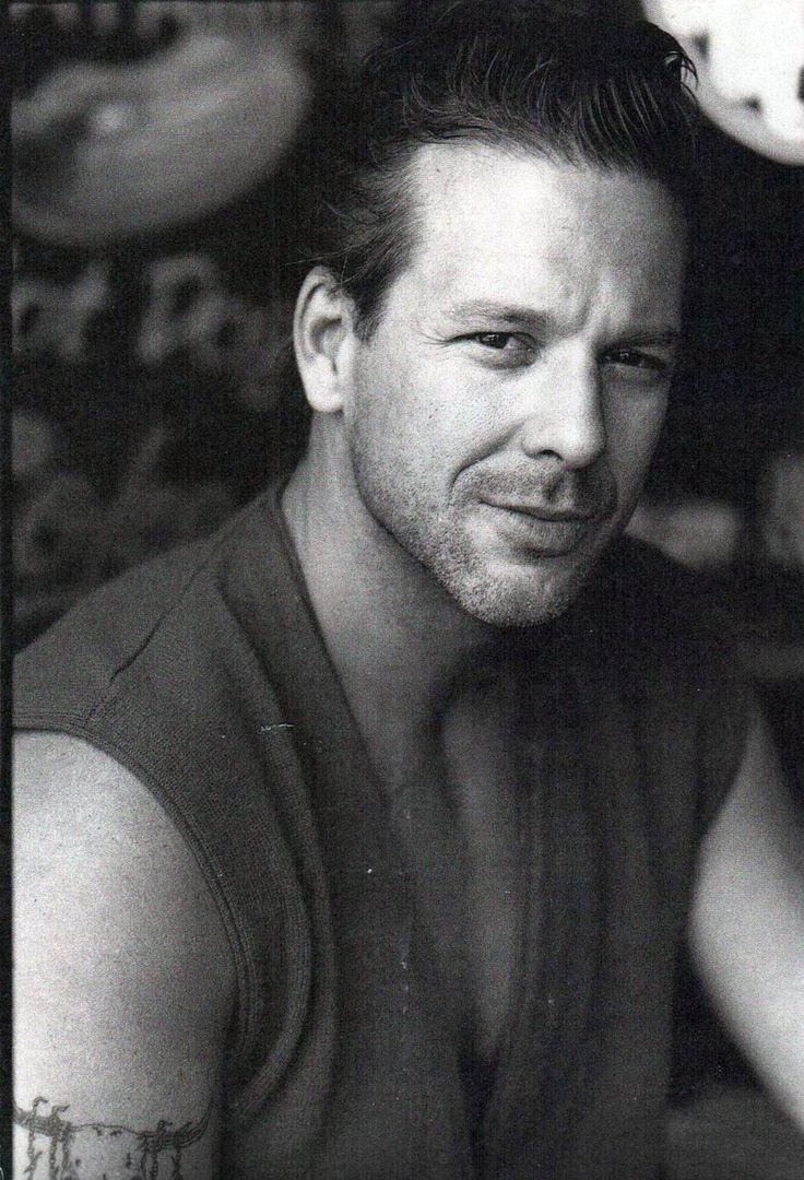 Mickey Rourke in his younger days. I always thought he was pretty good looking, until he had all that plastic surgery after his boxing career and ruined his face. *sigh*