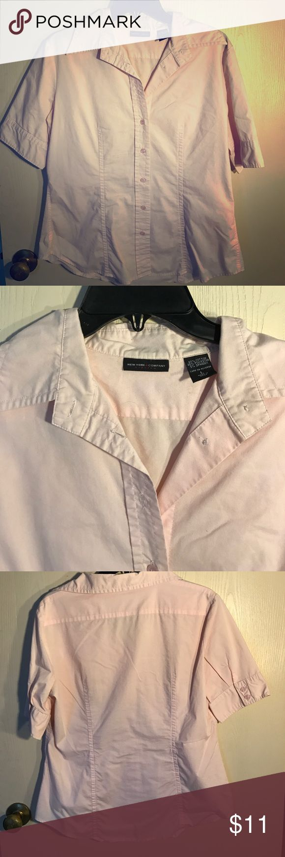 Light pink Short Sleeve Dress Shirt 👚 Light pink (almost white) button down shirt. Work once to job interview. Darting on front and back gives a feminine shape. Buttons on sleeves New York & Company Tops Button Down Shirts
