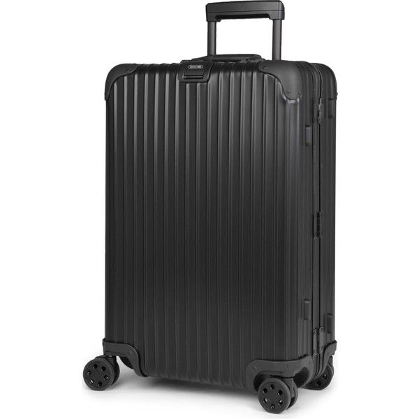 Rimowa Topas Stealth four-wheel suitcase 68cm (4.090 RON) ❤ liked on Polyvore featuring bags and luggage