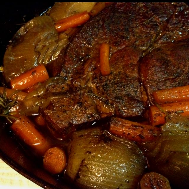 Homemade beef pot roast. I am going to switch things up a bit ... add whole mushrooms, brown meat & veggies in oil & butter mixture, add garlic of course and use beef consomme instead of red wine ... I will have my wine in a glass instead please;)