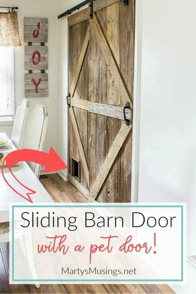 Learn how to build a sliding barn door (complete with a pet door!) with this step by step tutorial. #barnwood #DIY #barndoor #repurposed #rustic #fixerupper #martysmusings