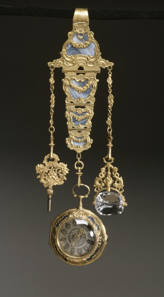 Decorative chatelaines were worn by men and women as pendants and multifunctional devices for carrying utensils like watches, signet seals, and sewing accessories. They were also suspended from the waistband.  18th century