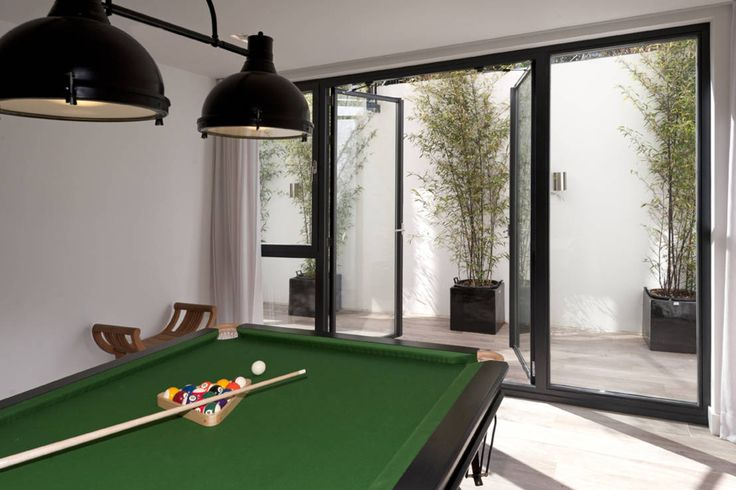 Villa Amsterdam Zuid : Moderne fitnessruimtes van paul seuntjens architectuur en interieur
