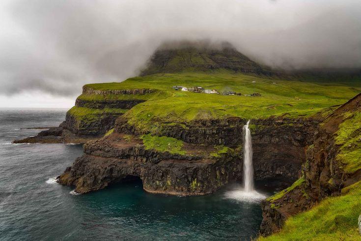 The spectacular Gásadalur Waterfall on the edges of the sea on the island of Vágar on the Faroe Islands.
