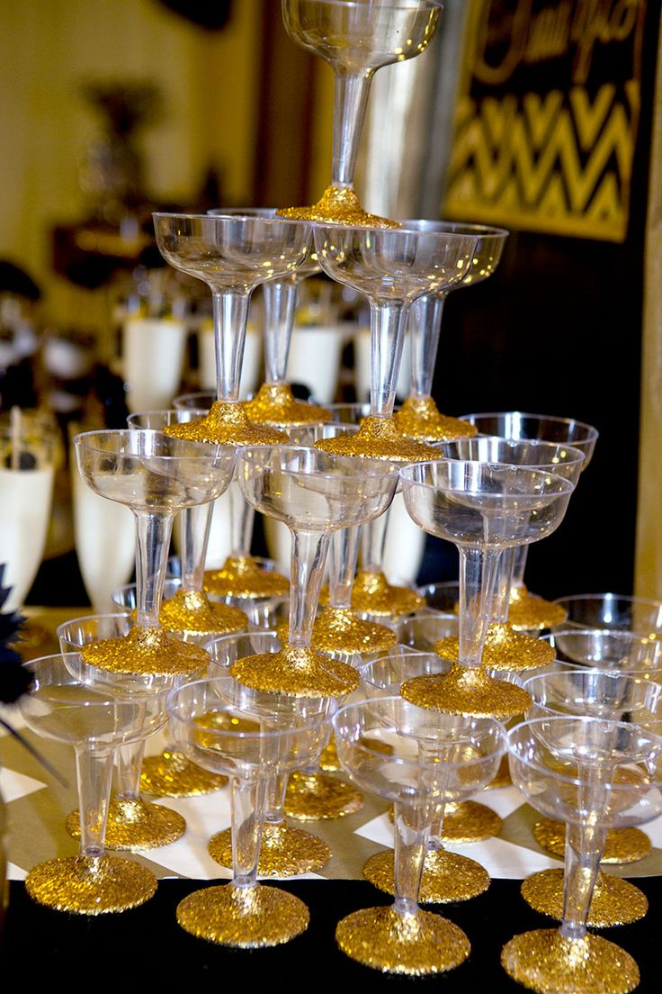 decorate champagne glasses. This amazing champagne tower was made using glasses from Hobby  Lobby and lots of gold Best 25 Plastic ideas on Pinterest