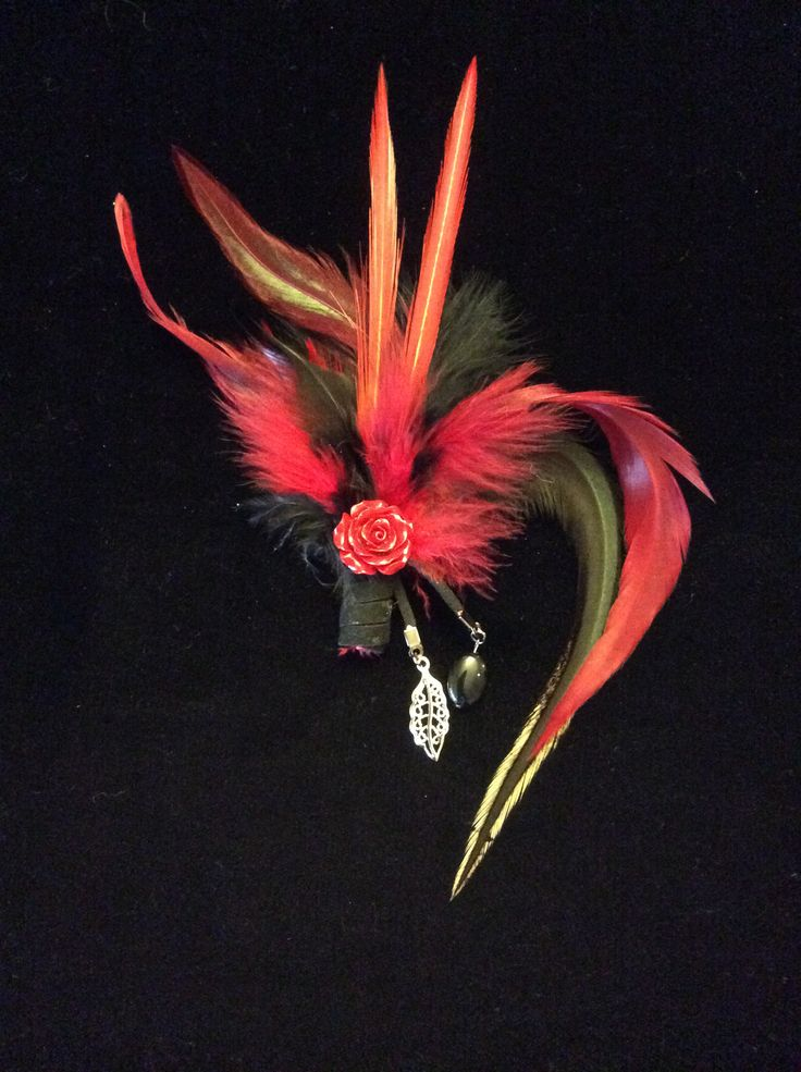 Feathers brooch with onyx