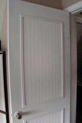 Add wallpaper bead board and trim to a plain door for a cheap door face lift.