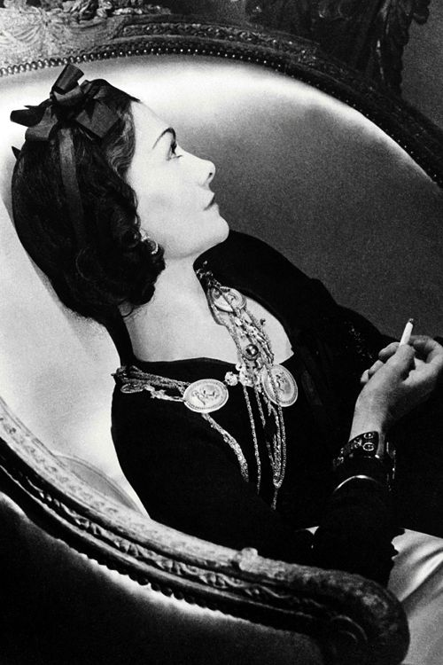 Gabrielle 'Coco' Chanel - 1937 - Paris. Love this pic of her and want a necklace with those medalians... so Coco!