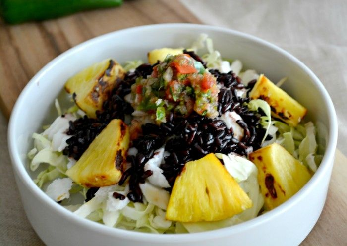 A refreshing taco bowl made with baked fish, black rice and grilled pineapple. This quick to make & assemble Pineapple Fish Taco Bowl will soon become your summer favorite.