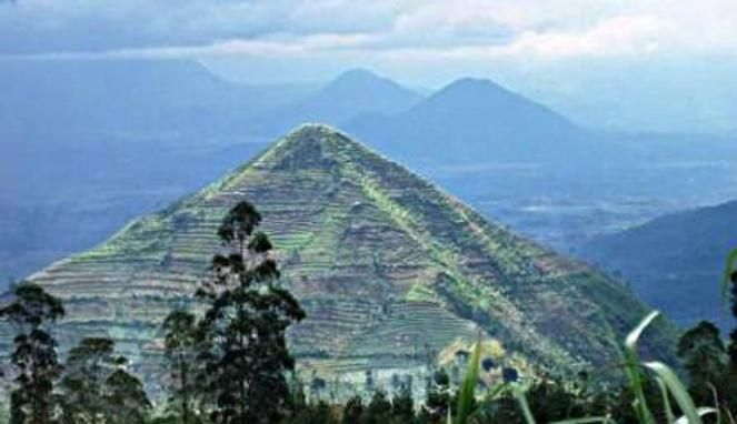 Gunung-Padang. Est. 20,000 - 12,000 years old. Step pyramid buried beneath the terraced slopes. What would be the possibility that the pyramid shaped mountains in the background are also step pyramids?