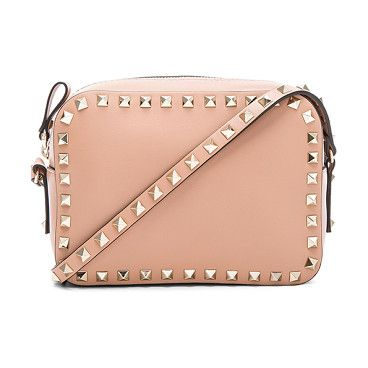 "Rockstud crossbody bag by Valentino. Genuine leather with canvas lining and gold-tone hardware.  Made in Italy.  Measures approx 7.5""""W x 5.25""""H x 2.5""""D..."