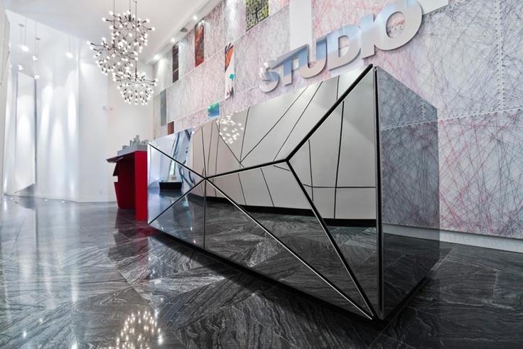 Mirror Reception Desk by Eventscape  segmented mirror parts on front of reception desk-R