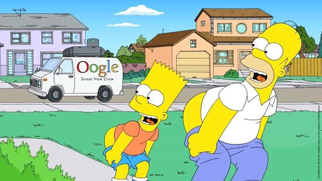 This is funny, Homer and Bart from the The Simpsons mooning the Google Street View Car crew.  Notice, the G is missing, with two large Oos.  Too funny.