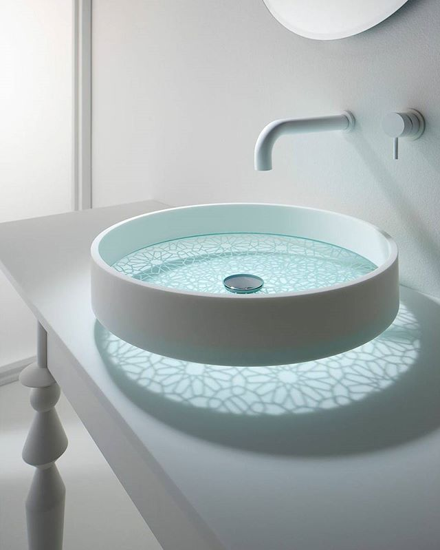 Beautiful round glass bottom Sink Design. Maybe have a pebble counter under it?