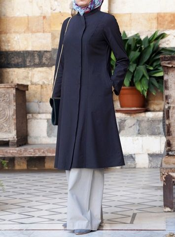 Amani Tunic Charcoal color Classy and clean-lined with a feminine silhouette, nothing could be more versatile than this tunic. Styled like a lightweight jacket, with a hidden placket front opening, this top is perfect for spring's transitional weather: great for layering when the weather is cooler. The styling possibilities are endless.