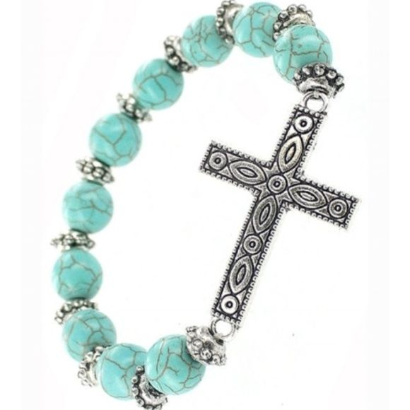 NEW Turquoise Silver Cross Bracelet NEW Turquoise Silver Stretch Charm Bracelet - 40mm long - Lead and Nickel Free  Please ask for a separate listing before purchasing  12 available Boutique Jewelry Bracelets
