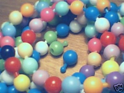 Oh my word!! Do you remember these pop beads? I had SO much fun with these when I was a child. There was no internet then. Kids went out to play and played all day. Lots of fun and loads of fresh air and sunshine. Aw I wish children today had that luxury. (That's really what it feels like to me now - it feels like I had a luxury that children today aren't lucky enough to have).