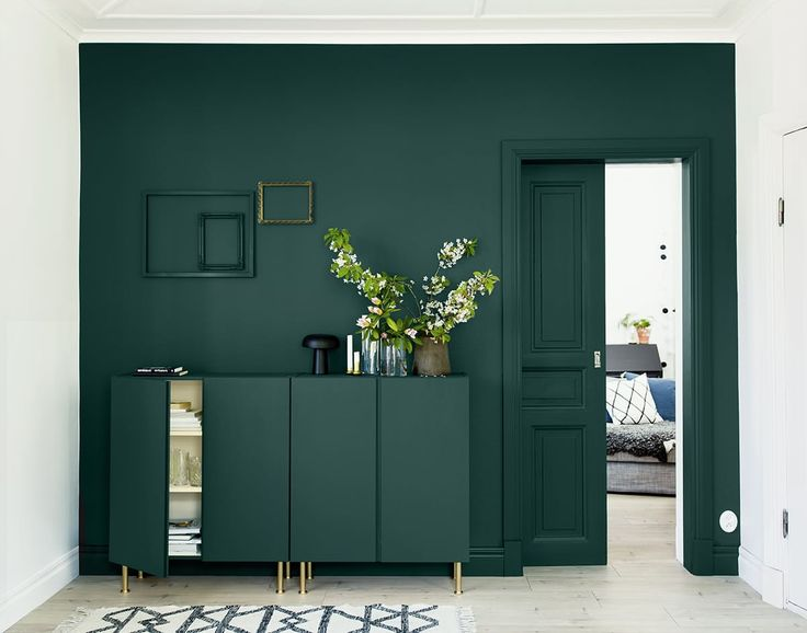 The Designer's Small Space Trick that Makes Any Room Look Larger A rich hunter green all over (and even on the door and door frame) makes everything on this wall read as a single entity. The effect is calming, unifying, and maybe just a little unexpected.