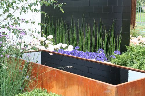 RHS Hampton Court Flower Show Vestra Wealth's Gray's Garden By garden designer Paul Martin. Paul Martin has taken inspiration for Vestra Wealth's Gray's Garden from the Irish designer, Eileen Gray, famous for her Modernist furniture and architecture // TheWaterGardener