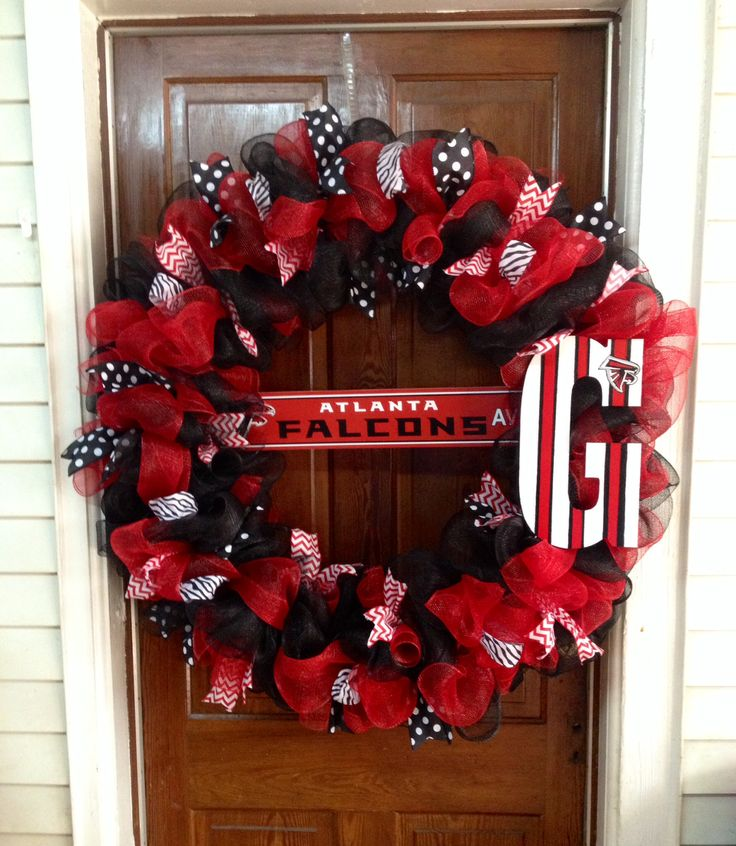 Atlanta Falcons Custom Wreath. HUGE! Check out  Toodle E. Doots Flowers & Gifts  Page on Facebook to order yours today!  Shipping available.