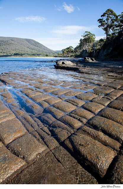 Tessellated Pavement, Tasmania, Australia. Looks like blocks of chocolate. Some rocks are so perfectly cut you would think they were done by hand. Definitely all natural.