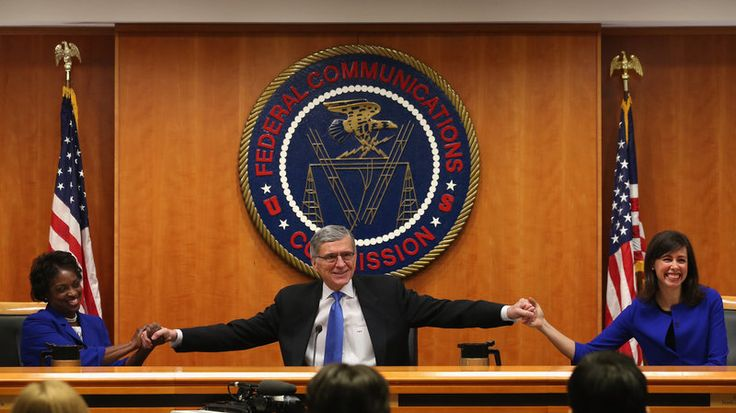 VICTORY!! FCC Approves Net Neutrality Rules For 'Open Internet' - At the start of a meeting to decide the issue of net neutrality, Federal Communications Commission Chairman Tom Wheeler, center, holds hands with FCC Commissioners Mignon Clyburn, left, and Jessica Rosenworcel at the FCC headquarters Thursday.