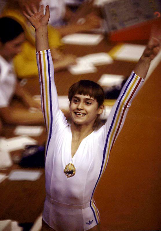 Nadia Comaneci - Five Gold Medals, Three Silver, One Bronze, Gymnastics - Top Olympic Pioneers - Photos - SI.com