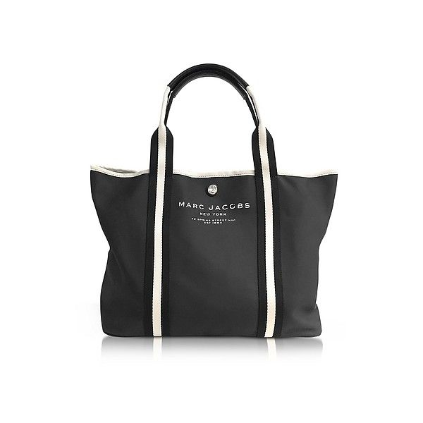 Marc Jacobs Handbags Black Canvas EW Tote ($250) ❤ liked on Polyvore featuring bags, handbags, tote bags, black, marc jacobs tote, purse tote, striped tote, marc jacobs handbags and mini tote