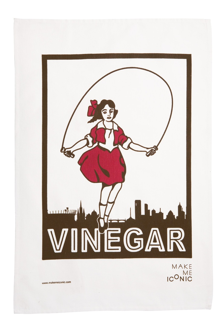 Skipping Girl tea towel. After lighting up Victoria Street for over seventy years Little Audrey is shown here skipping in front of Melbourne's skyline.